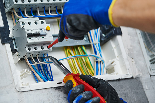 Electrician assembling power switchboard